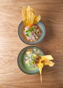 Ceviche a la crema de rocoto y aguacate y ceviche verde con huacatay y mango