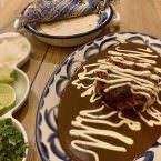Pato con mole poblano, Chihuahua tacos y tragos