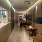 Interior restaurante Pante y cocina vista